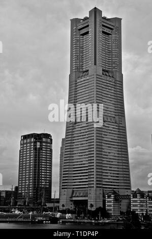 Yokohama, Japan - 7th July 2018 : Black & White picture of the Yokohama Landmark Tower that was built in 1993. The tower is the 4th tallest building i - Stock Photo