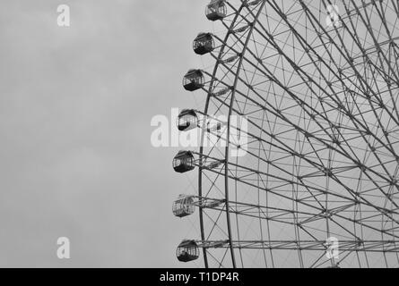 Beautiful black and white picture of a part of the huge ferris wheel in Yokohama City in Japan - Stock Photo