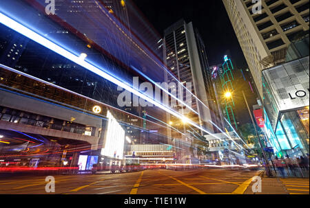 long exposure in the heart of city in Hong Kong - Stock Photo