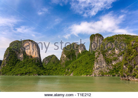 Halong Bay rock formations on a sunny day, UNESCO world natural Heritage, Vietnam. - Stock Photo