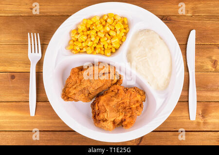 Fried chicken tv dinner on wooden background, top view. - Stock Photo
