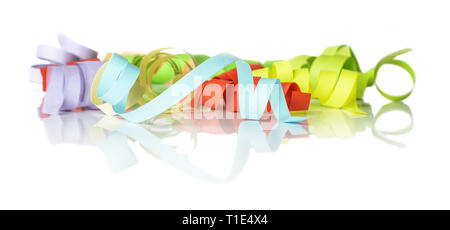 Multicolored paper ribbons twisted into a spiral isolated on a white background - Stock Photo