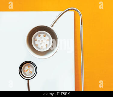Close-up of a LED lamps white and red color. Round table lamps with a new technology lamps on white and yellow background. - Stock Photo