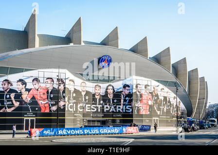 Main entrance of the Parc des Princes stadium in Paris, France, covered with a fresco of the players of the Paris Saint-Germain football club team. - Stock Photo