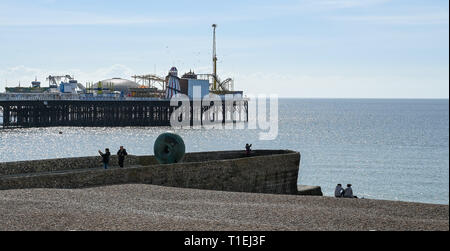 Brighton, UK. 26th Mar, 2019. Visitors enjoy a beautiful sunny Spring day on Brighton Beach as the weather is forecast to be warm with sunshine throughout Britain over the next few days Credit: Simon Dack/Alamy Live News - Stock Photo