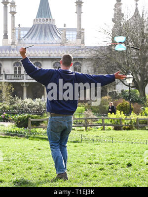 Brighton, UK. 26th Mar, 2019. Shane McQuire hones his diablo skills by Brightons Royal Pavilion on a lovely sunny Spring day as the weather is forecast to be warm with more sunshine throughout Britain over the next few days Credit: Simon Dack/Alamy Live News - Stock Photo