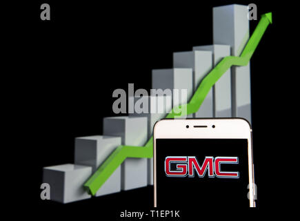 Hong Kong. 10th Feb, 2019. In this photo illustration a American automobile manufacturer company General Motors GMC logo is seen on an android mobile device with an ascent growth chart in the background. Credit: Budrul Chukrut/SOPA Images/ZUMA Wire/Alamy Live News - Stock Photo