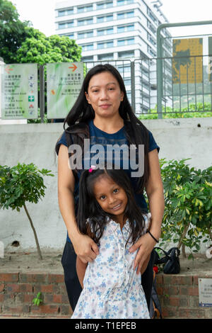 Hong Kong, China. 2nd Aug, 2017. Castle Peak Bay Immigration Centre. 84 Castle Peak Road. Castle Peak Bay, Tuen Mun. The Snowden refugees at CIC. VANESSA MAE RODEL with daughter Keana after signing on at CIC. Vanessa and her daughter are the first of the Snowdon guardian angels to have been resettled in Canada. A victim of violence and human trafficking, she helped shelter former CIA whistleblower Edward Snowden when he fled to Hong Kong. She has now been granted refugee status in Canada arriving on the 25th March 2019. Credit: Jayne Russell/ZUMA Wire/ZUMAPRESS.com/Alamy Live News - Stock Photo