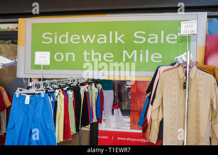 Miami Coral Gables Miami Florida Coral Way Miracle Mile store clothing clothes shop business sidewalk sale hangers bargain sign price - Stock Photo