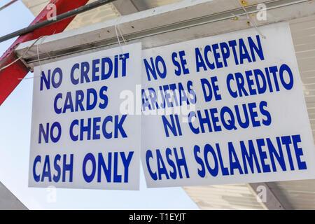 Miami Florida business sign cash only no credit card no checks bilingual Spanish English language - Stock Photo