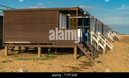 Beach huts on the shore of the River Thames, seen in Southend-on-Sea, Essex, England, UK - Stock Photo