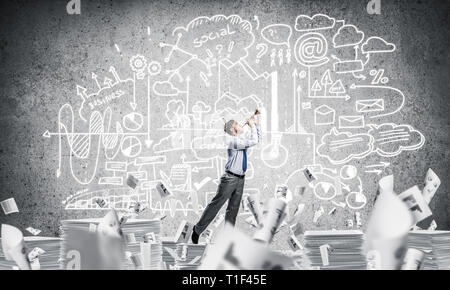 Happy businessman playing fife. - Stock Photo