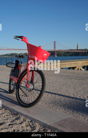 Bicycle on the sideways of river Tejo in Lisbon - Stock Photo
