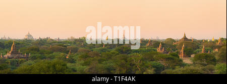 Stunning panoramic view of the Bagan ancient city (formerly Pagan) during sunset. The Bagan Archaeological Zone is a main attraction in Myanmar. - Stock Photo