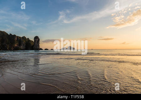 Sunset at Ao Nang beach in Thailand - Stock Photo