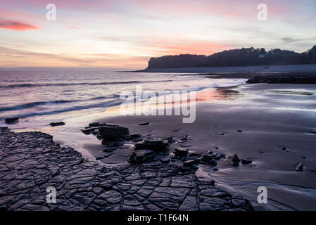 A tranquil coastal and seascape scenic view at sunset at Barry, South Wales - Stock Photo
