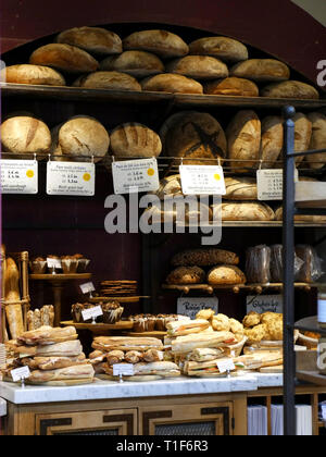 Bread and baguettes for sale in a small independent bakers in Covent Garden, London, UK - Stock Photo