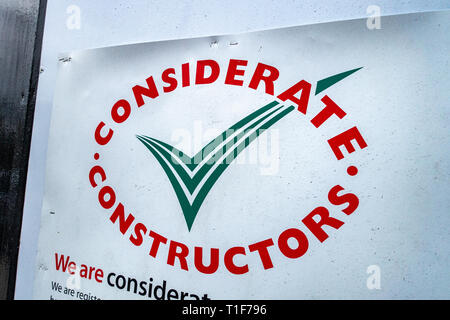 Considerate constructors sign on construction site development security wall - Stock Photo