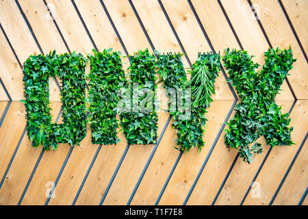 Onyx name logo planted in three-dimensional sign made with greenery plants at a building development - Stock Photo