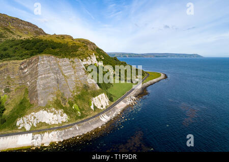 Northern Ireland, UK. Atlantic coast. Cliffs and A2 Antrim Coast Road, a.k.a. Giants Causeway Coastal Route. One of the most scenic coastal roads in E - Stock Photo