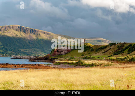 Western coast of County Antrim, Northern Ireland, UK, with the ruin of medieval Red Bay Castle, cliffs near Glenariff, Watrerfoot and Cushendall at co - Stock Photo