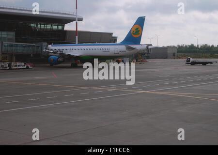 Kazan, Russia - Jul 19, 2018: Passenger plane at teleladder at airport - Stock Photo