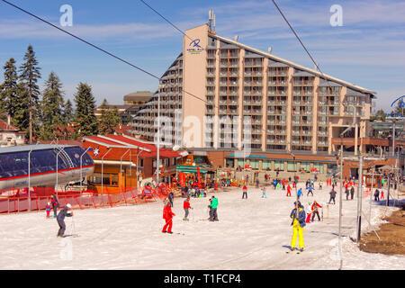 Borovets Ski Resort near Samokov in Bulgaria with nursery slope drag-lift and the Rila Hotel. - Stock Photo