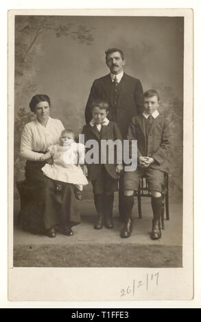 WW1 era studio formal family portrait postcard, dated 26 Feb 1917 - Stock Photo