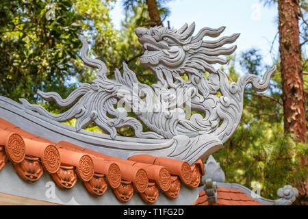 Dragons on the roof of Truc Lam Tay Thien Zen Buddhist Monastery near Hanoi, Vietnam. - Stock Photo