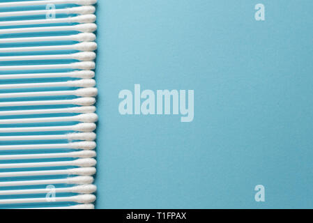 Cotton swabs on a blue background.top view.disk for beauty face hygiene . Beauty, skin, body care concept.selective focus. place for text. - Stock Photo