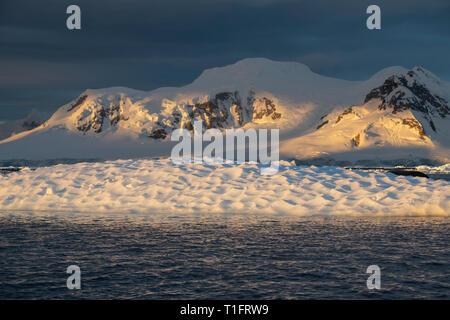 Antarctica, Paradise Harbour aka Paradise Bay aka Paradise Harbour. Late season polar sunset. - Stock Photo