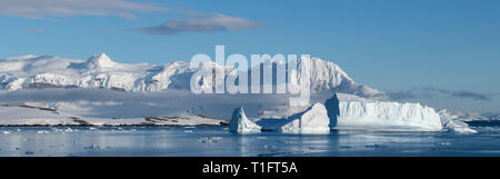 Antarctica. Cuverville Island located within the Errera Channel between Ronge Island and the Arctowski Peninsula. Ice filled bay. - Stock Photo
