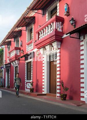 Red colonial house in old Latin Quarter Fontainhas (Panaji), Panjim, Goa, India - Stock Photo