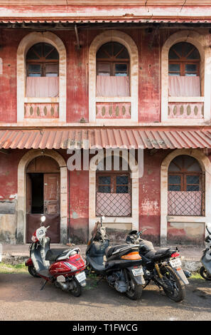 Motorbikes in front of an old house in Fontainhas, Panaji (Panjim), Goa, India - Stock Photo