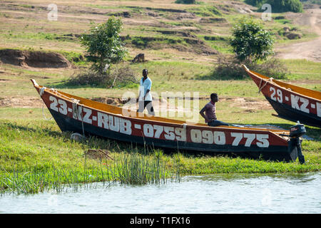 Local fisherman with their boats beside Kazinga Channel within Queen Elizabeth National Park, South West Uganda, East Africa - Stock Photo