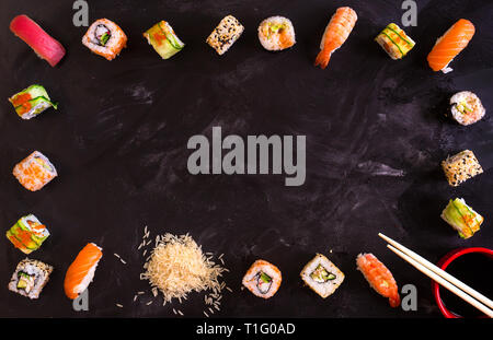 Sushi set on dark background. Minimalism - Stock Photo