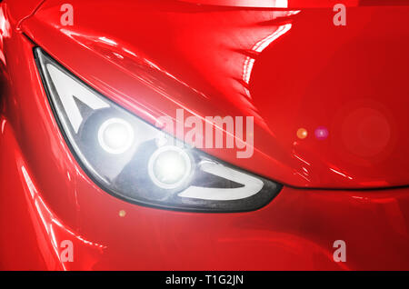 Headlight of a red sports car. - Stock Photo