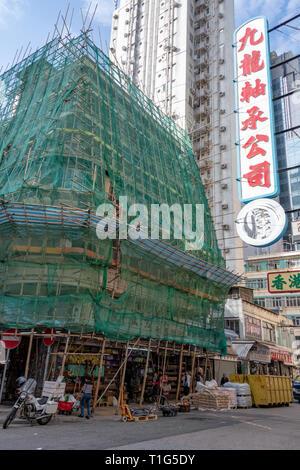 Bamboo Scaffolding n Building, Kowloon, Hong Kong - Stock Photo