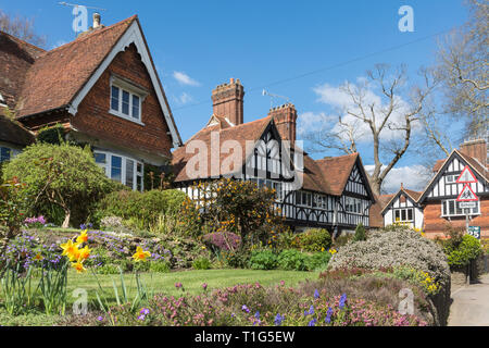 Character cottages (timber framed houses) and gardens in the village of Witley in Surrey, UK, during spring. - Stock Photo