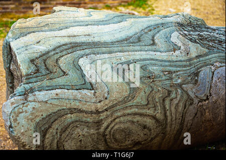 Close-up detail on a fallen marble column in the Roman Forum. Beautiful abstract pattern and texture in blue. - Stock Photo
