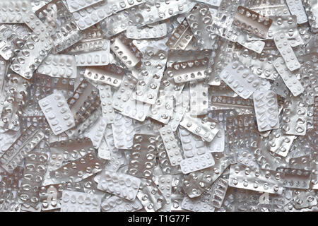 Many empty blister packages on white background, drug overdose, misuse or addiction concept - Stock Photo