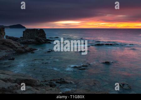 Sunrise on the coast of Escullos. Natural Park Cabo de Gata. Spain. - Stock Photo
