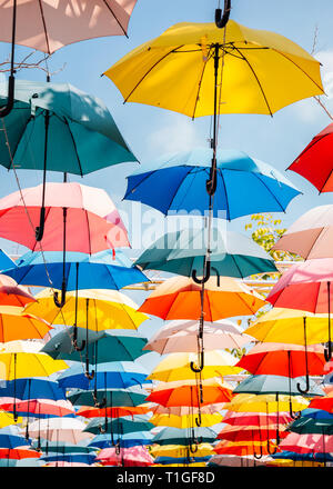 Colorful umbrella background in the sky - Stock Photo