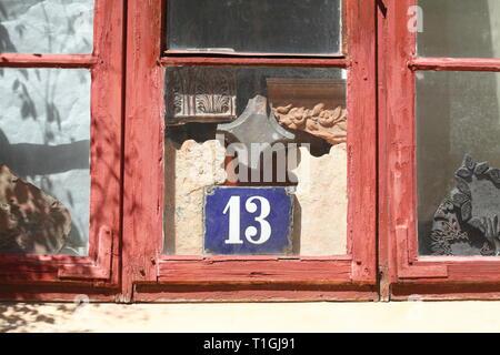 House number plate number thirteen in an old window, old town, Wismar, Mecklenburg-Vorpommern, Germany I Hausnummernschild Nummer Dreizehn  in einem a - Stock Photo