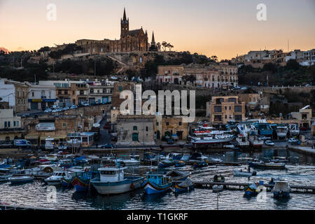 Mġarr Harbour at dusk, Gozo, Malta - Stock Photo