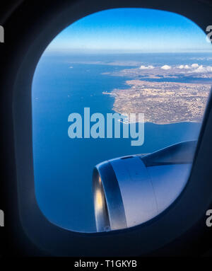 Travel, cloudscape and natural environment concept - View from the airplane window, sky and ocean blue - Stock Photo