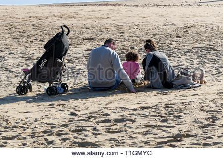 Family on beach, Bournmouth, Dorset, England, UK - Stock Photo