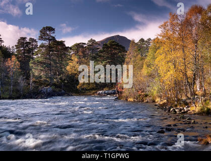 River Affric backed by Sgurr Na Lapaich in autumn, Glen Affric, Highlands, Scotland, UK - Stock Photo