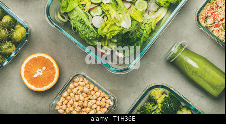 Healthy vegan dishes in glass containers. Flat-lay of vegetable salads, legumes, beans, sprouts, hummus and fresh juices in bottles over concrete tabl - Stock Photo