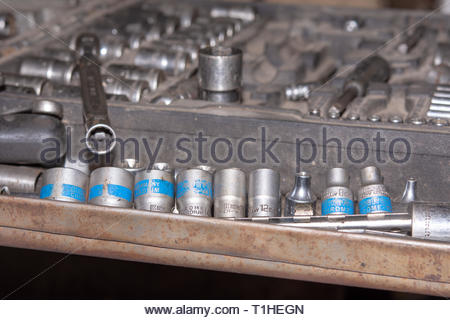 Set of round mechanic tools in the box. Car mechanic concept in the old mechanic workshop - Stock Photo